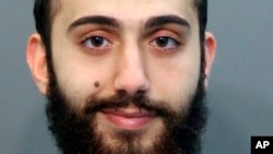 FILE - This April 2015 booking photo released by the Hamilton County, Tenn., sheriff's office shows a man identified as Muhammad Youssef Abdulazeez, who had been detained for a driving offense.