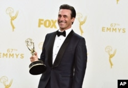 "Jon Hamm with the award for outstanding lead actor in a drama series for ""Mad Men"" poses in the press room at the 67th Primetime Emmy Awards at the Microsoft Theater in Los Angeles, Sept. 20, 2015."