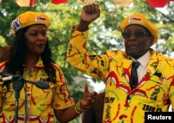 file: President Robert Mugabe and his wife, Grace, attend a rally of his ruling ZANU-PF party in Harare, Zimbabwe, Nov. 8, 2017.
