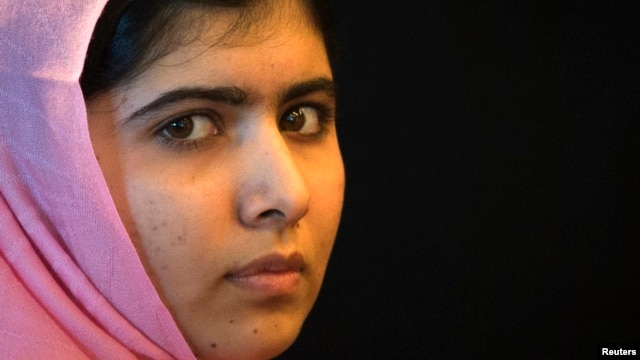 Malala Yousafzai, the Pakistani girl who was shot on a school bus by the Taliban last October for campaigning on the education of girls, sits on the sidelines of a news conference convened by 'A World at School' in New York, Sept. 23, 2013.