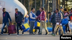 Eritrean migrants arrive at Lulea airport, Kallax, Sweden, having flown from Rome's Ciampino airport, October 9, 2015.