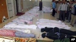Сирия. Жертвы убийств в Хуле.