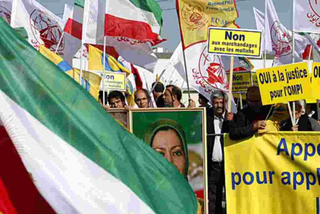 Iranian dissidents wave their national flag and various Islamic flags during a demonstration, July 10, 2008, in front of the European Parliament in Strasbourg, France, to have the People's Mujahedeen Organization of Iran removed from the EU terror list