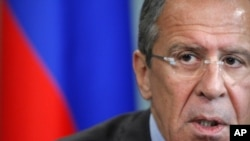 Russian Foreign Minister Sergei Lavrov, answers questions during Moscow news conference, June 28, 2012.