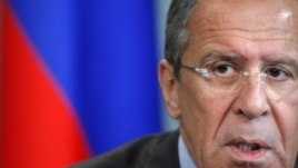 Russian Foreign Minister Sergei Lavrov, answers questions during Moscow news conference, June 28, 2012