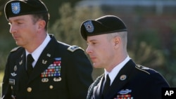 FILE - Army Sgt. Bowe Bergdahl, right, arrives for a pretrial hearing at Fort Bragg, N.C., with his defense counsel, Lt. Col. Franklin D. Rosenblatt, Jan. 12, 2016.