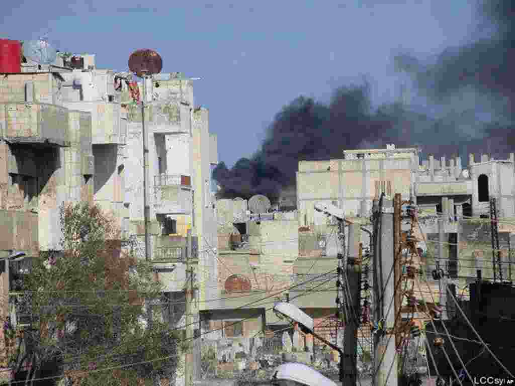 Black smoke rising from Syrian government shelling at Baba Amr neighborhood in Homs, February 12, 2012 (AP/Local Coordination Committees in Syria)