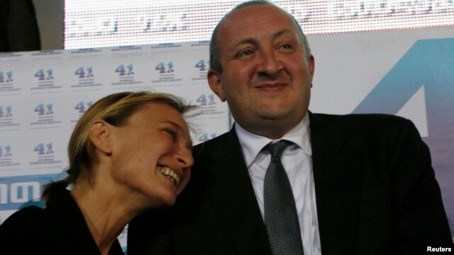 Presidential candidate Georgy Margvelashvili (R) celebrates his victory in Sunday's presidential election with his partner Maka Chichua at the Georgian Dream coalition's headquarters in Tbilisi, Oct. 27, 2013.