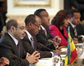 Ethiopian Prime Minister Meles Zenawi, first from left, and his delegation attend a meeting with Egyptian Prime Minister Essam Sharaf, not pictured, in Cairo, Egypt, September 17, 2011 to discuss Ethiopia's planned Nile River dams.