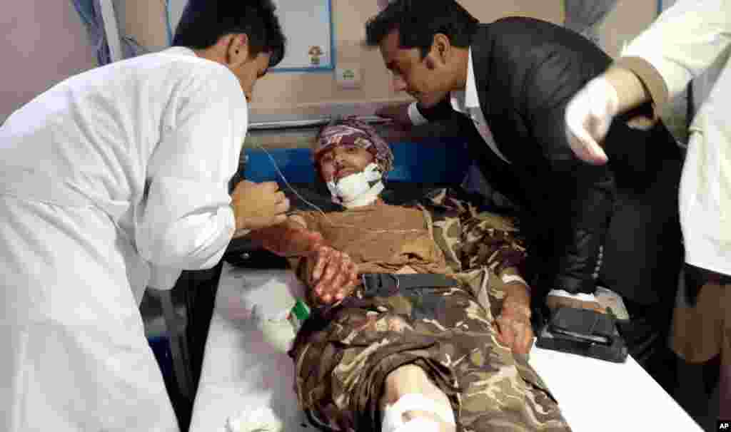 Afghan medics help an injured man receive treatment at a hospital after a suicide attack in Faryab province, north of Kabul, July 22, 2015.