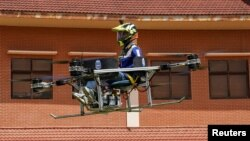 Lonh Vannsith, a fourth-year student of the National Polytechnic Institute of Cambodia, flies his team?s drone in Phnom Penh, Cambodia, September 17, 2021. (REUTERS/Cindy Liu)