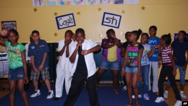 Younger members of Studio Heat performing at the release party for the music clubhouse's second CD, 'Because of You.'