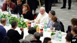 Pope Francis sits at a lunch, at the Vatican, Nov. 18, 2018.