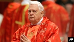 FILE - In this March 12, 2013, photo, Cardinal Bernard Law attends a Mass for the election of a new pope celebrated inside St. Peter's Basilica, at the Vatican.