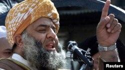 Maulana Fazlur Rehman, leader of the Jamiat-e-Ulema Islam party, speaks during an anti-U.S. demonstration in Peshawar, Oct. 6, 2001.