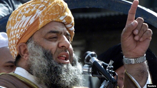Maulana Fazlur Rehman, leader of the Jamiat-e-Ulema Islam party, speaks during an anti-U.S. demonstration in Peshawar, Oct. 6, 2001.