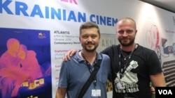 Фото: Валентин Васянович и Андрей Римарук на украинском стенде кинорынка в Торонто. Photo: Oleg Sulkin