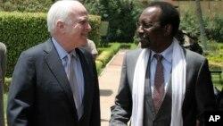 U.S. Senator John McCain, left, meets with Mali's interim President Dioncounda Traore, in Bamako, Mali Tuesday, Apr. 2, 2013.