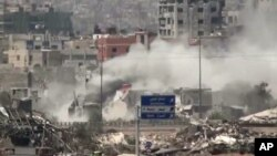 Image shows shelling of the Al-Qaboun neighborhood in rural Damascus, Syria, July 15, 2013.