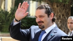FILE - Former Lebanese prime minister Saad al-Hariri arrives at the government's headquarters in Beirut, Aug. 8, 2014.