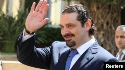 Former Lebanese prime minister Saad al-Hariri gestures upon his arrival at the government's headquarters in Beirut, August 8, 2014.