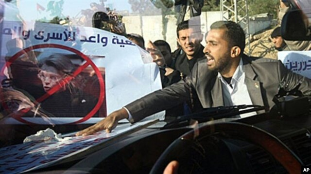 Angry Palestinian demonstrators mob French Foreign Minister Michele Alliot-Marie's armored car at Beit Hanun in the Gaza Strip, 21 Jan 2011