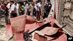 Civili blizu mesta napada u istočnom delu Bagdada