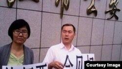 北京律师李春富、王宇。 (资料图片)