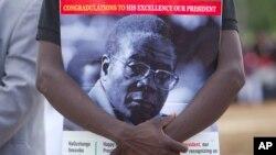 Umfanekiso kamongameli Mugabe.