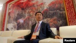 Wang Jianlin, chairman of Chinese property developer Dalian Wanda Group, sits in a meeting room as he arrives for the launch ceremony for the Qingdao Oriental Movie Metropolis on the outskirts of Qingdao.