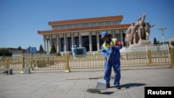 A cleaner sweeps ground in front of the Mausoleum of late Chinese chairman Mao Zedong at Tiananmen Square on the 50th anniversary of the start of the Cultural Revolution in Beijing, China, May 16, 2016.