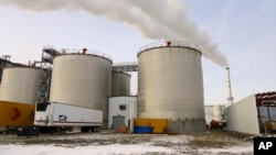 FILE - Steam blows over fermentation tanks at the Green Plains ethanol plant in Shenandoah, Iowa, Jan. 6, 2015.