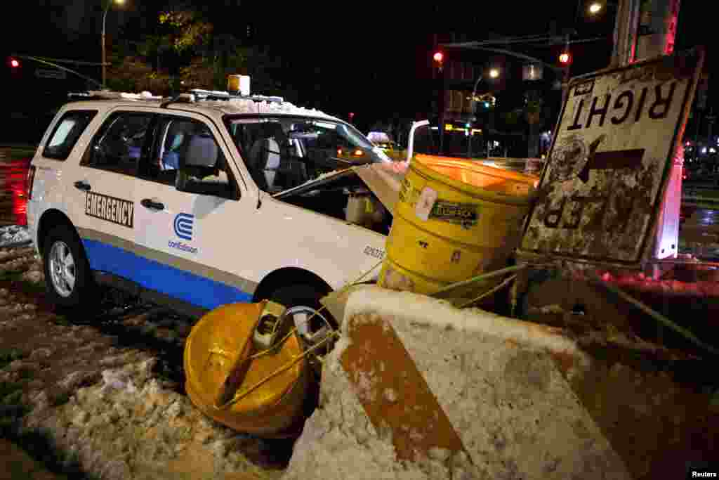 A Con Edison emergency vehicle crashes into a barricade after a nor'easter storm in New York, November 8, 2012.