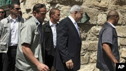 Israeli Prime Minister Benjamin Netanyahu, second from right, arrives at a special cabinet meeting marking upcoming Jerusalem Day at the Tower of David Museum, near Jaffa Gate in Jerusalem's Old City, May 29, 2011