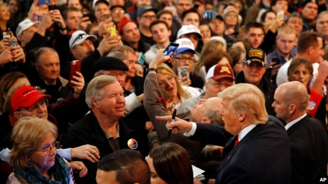 People greet Republican presidential candidate Donald Trump, bottom right, after he spoke at a rally at the Surf Ballroom in Clear Lake, Iowa, Jan. 9, 2016.