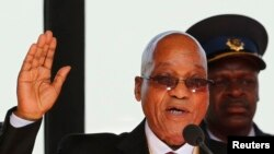 South African President Jacob Zuma takes his oath of office during his inauguration ceremony at the Union Buildings in Pretoria May 24, 2014.