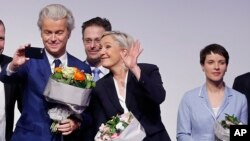AfD (Alternative for Germany) chairwoman Frauke Petry, right, Far-right leader and candidate for next spring presidential elections Marine le Pen from France, center, and Dutch populist anti-Islam lawmaker Geert Wilders, left, stand together after their speeches at a meeting of European Nationalists in Koblenz, Germany, Saturday, Jan. 21, 2017. (AP Photo/Michael Probst)