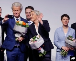 AfD (Alternative for Germany) chairwoman Frauke Petry, right, Far-right leader and candidate for next spring presidential elections Marine le Pen from France, center, and Dutch populist anti-Islam lawmaker Geert Wilders stand together after their speeches at a meeting of European Nationalists in Koblenz, Germany, Saturday, Jan. 21, 2017.