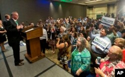 FILE - Republican gubernatorial candidate Ed Gillespie delivers a victory speech June 13, 2017, in Richmond, Va. Gillespie beat state Sen. Frank Wagner and Corey Stewart in a primary election.