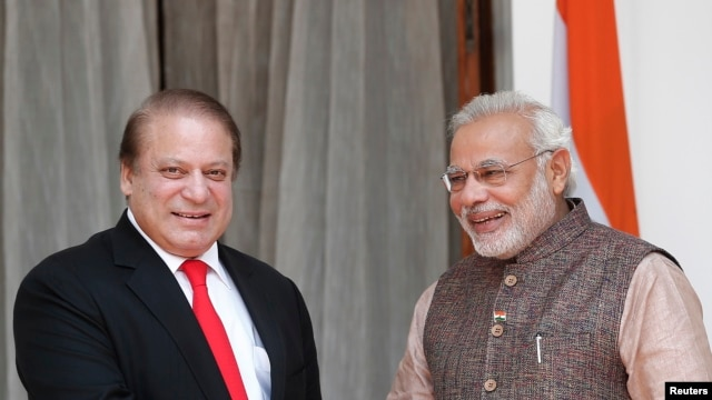 India's Prime Minister Narendra Modi and his Pakistani counterpart Nawaz Sharif smile before the start of their bilateral meeting in New Delhi, May 27, 2014.