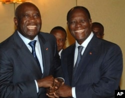 FILE - Former Ivory Coast President Laurent Gbagbo, left, and incumbent Alassane Ouattara posed for a photo before the 2010 ballot.