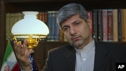 Iranian Foreign Ministry Spokesman Ramin Mehmanparast speaks with a Reuters correspondent during an interview in Tehran, June 29, 2011