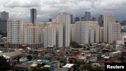 Rows of condominium buildings are seen behind a middle-class residential district in Mandaluyong, Metro Manila. The economy grew 6.4 percent in the first three months of the year, second only to China, July 4, 2012.
