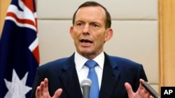 FILE - In this April 12, 2014, Australian Prime Minister Tony Abbott speaks during a press conference at a hotel in Beijing, China.