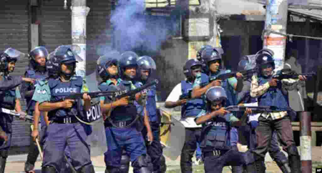 Bangladeshi policemen disperse protesters in Rajshahi, Bangladesh, Friday, March 1, 2013. Protesters clashed with police for a second day Friday as the death toll rose to at least 44 in clashes triggered by a death sentence given to Delwar Hossain Sayedee