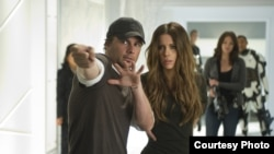 Director Len Wiseman (left foreground) and actor Kate Beckinsale (right foreground) on the set of Columbia Pictures' action thriller TOTAL RECALL.