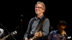 Eric Clapton performs at Eric Clapton's Crossroads Guitar Festival 2013 at Madison Square Garden on Sunday April 14, 2013 in New York. (Photo by Charles Sykes/Invision/AP)