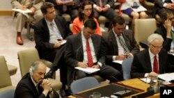 ویتالی چورکین (راست) نماینده روسیه و بشار جعفری نماینده سوریه در سازمان ملل