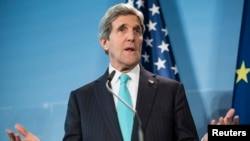 U.S. Secretary of State John Kerry makes a statement at a joint news conference with Germany's foreign minister (not pictured) at Berlin Tegel Airport, Jan. 31, 2014.