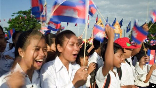 Cambodia students hold the Cambodian national flags as they attend the Independence Day celebration at the Independence Monument in the capital Phnom Penh.